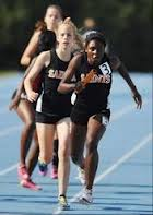 St. Charles East boss their way to IL#1 3:58.73 4x4r win/Daily Herald image